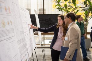 An undergraduate student presents her research at a conference.
