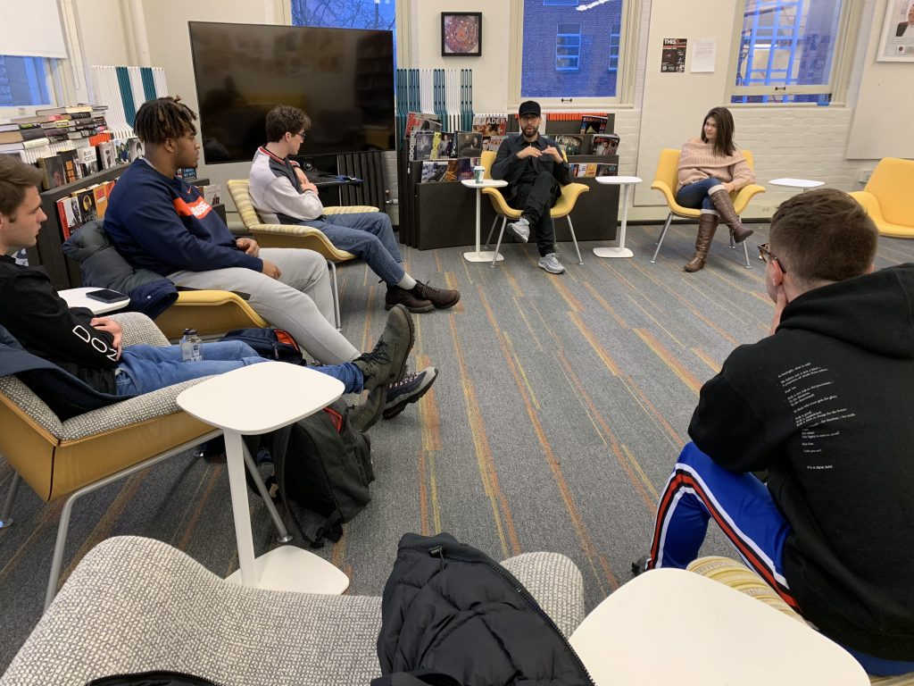 Students meeting with Cody Verdecias from Atlantic Records.