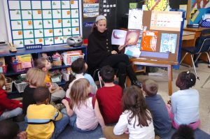 Syracuse student working with children in Syracuse City School District.