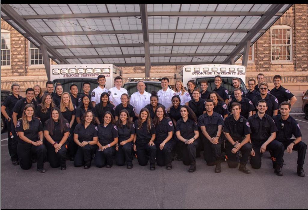 Sarah Koutana '20 (middle, 5th from right) with the Syracuse University Ambulance Squad (SUA). Photo courtesy of SUA.