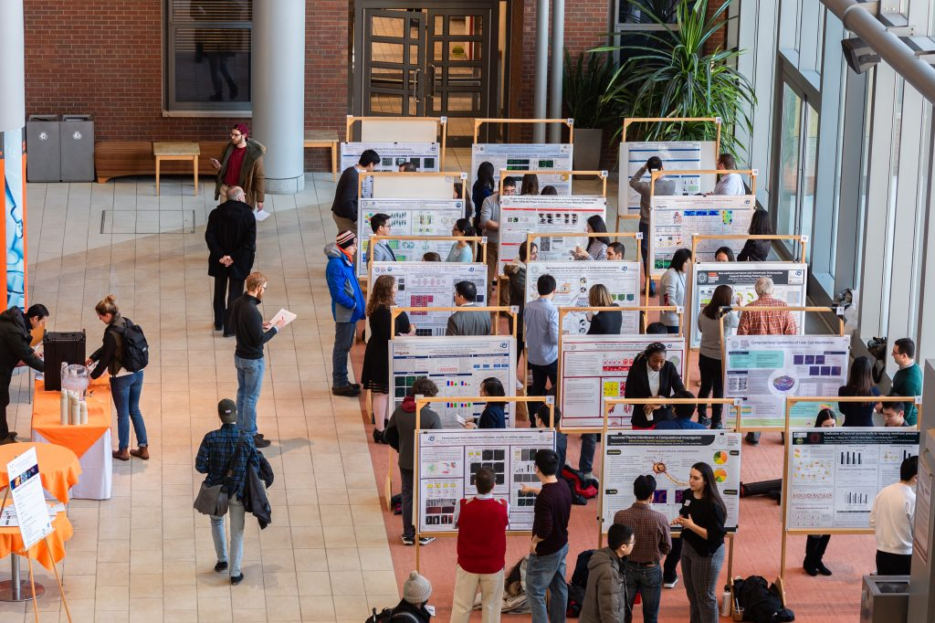 Students presenting their research at a poster session for Syracuse's Biomaterials Institute.