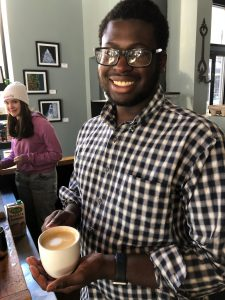 Seth '22 with Slow Food, a Syracuse student organization that connects students on and off-campus with sustainable food enterprises. Photo courtesy of Seth Martin, Jr.