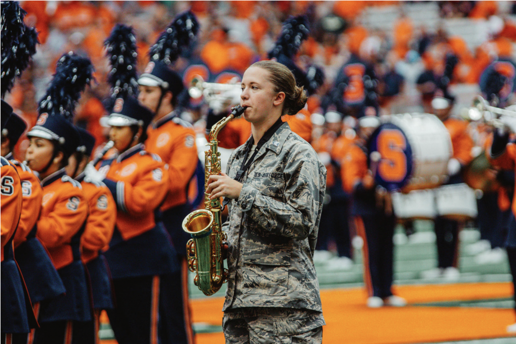Erin '22 plays the alto sax in the Syracuse University Marching Band.